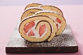 Sponge roll with chocolate icing and strawberry filling