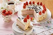 Strawberry cream cake with flaked almonds to serve with coffee