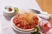 Strawberry cheesecake with spun sugar