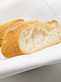 Two baguette slices on white fabric napkin