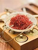 Saffron threads in scale pan