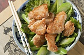 Chicken fillet with sesame seeds on broccoli (Asia)