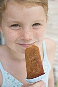 Girl holding an ice lolly