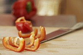 Red pepper, partly cut into strips