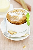 Rhubarb soufflé dusted with icing sugar
