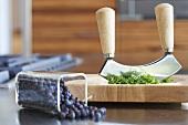Chopped parsley with mezzaluna, juniper berries