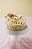 Pear cake with flaked almonds on cake stand