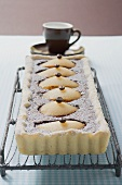 Pear and chocolate tart with mocha beans, espresso cup