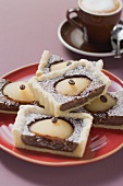 Several pieces of pear and chocolate tart and cappuccino