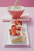 Several puff pastry slices with strawberries & cream