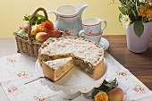 Apple pie, a piece cut, fresh apples, coffee cups