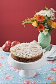 Apple crumble cake with icing sugar