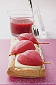Poached pear puff pastry tart