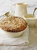 Fruit crumble with slivered almonds, custard