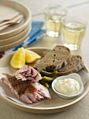 Smoked fish with mayonnaise, gherkins and bread