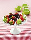 Chocolate-dipped strawberries on cake stand