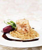 Grilled fish fillet with white beans and red wine sauce