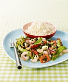 Stir-fried prawns and vegetables, side dish of rice