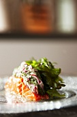 Salmon with salad on glass plate