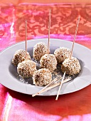 Walnut and sesame seed balls on toothpicks