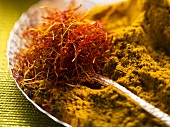 Spices for pasta and rice (saffron threads and curry powder)