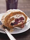 Cinnamon roulade with cherry compote filling