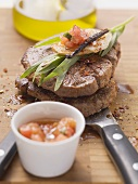Beef fillet steaks with tomato and tarragon