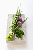 A bunch of chives with flowers and snipped chives