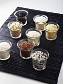 Various types of rice in glasses
