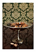 Macadamia nuts on a silver dish