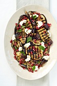 Grilled aubergine with mozzarella and pomegranate seeds
