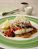 Poached fillet of fish with napoletana sauce on sweet potato hash browns