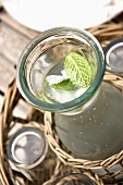 A carafe of water with mint and ice cubes