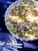 Quark cream with grapes and flaked almonds