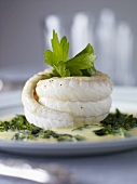 Sole rolls on a herb sauce