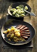 Duck with sauerkraut and herb gnocchi