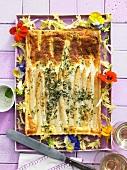 Asparagus tart with edible flowers