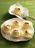 White chocolate pralines with chili powder