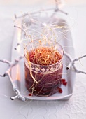 Pomegranate grog with caramel strands