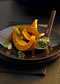 Roasted pumpkin slices with pesto