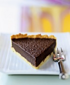 A piece of chocolate tart