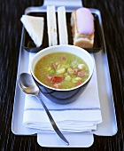 Pea soup with bacon, bread and ice cream cake