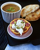 Lentil soup with flatbread and pomegranate with crème fraîche