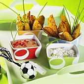 Potato wedges with dips and football