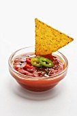 Tortilla chips with tomato and pepper dip