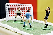 Football pitch cake with players and referee