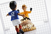 Football cake with footballer and goalkeeper