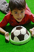 Boy with football cake