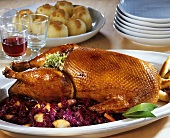 Roast goose with apple and red cabbage and potato dumplings