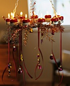 Hanging wreath with candles and tree ornaments
